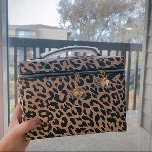 Estee lauder cosmetic bag animalprint faux leather